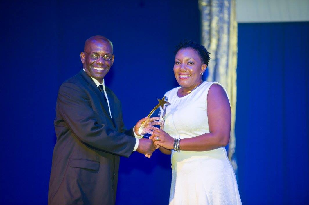 Communications Supervisor Jamila Samuel receives the GCIC Award for Service Excellence